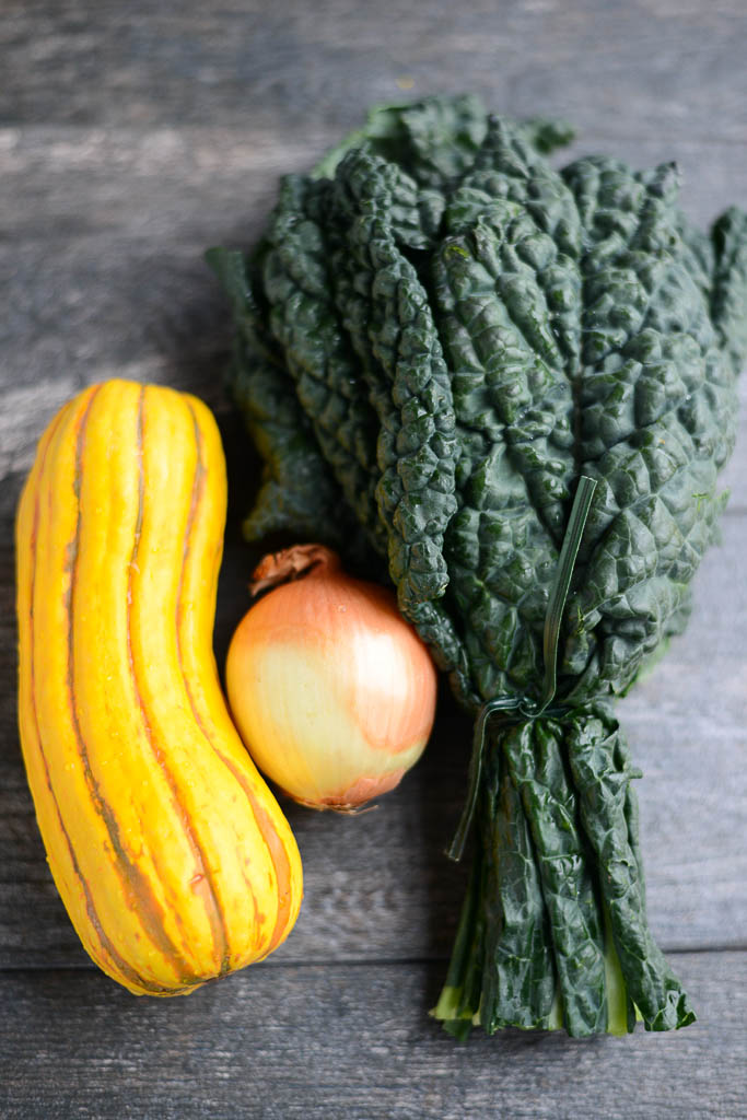 Kale, onion, and delicata squash for Hearty Winter Pasta.