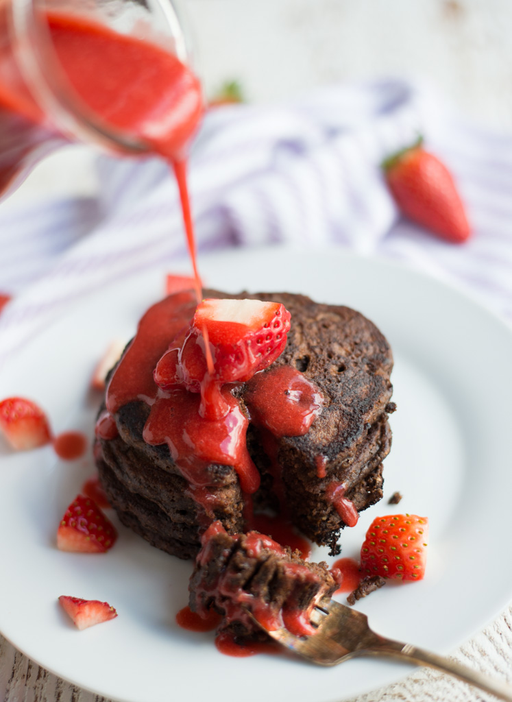 Decadently rich, easy to prepare, and made with good-for-you ingredients, One-Bowl Chocolate Pancakes with Strawberry Syrup is a special yet simple recipe, perfect for a special occasion or an everyday breakfast. Gluten-free, dairy-free, and refined sugar-free.