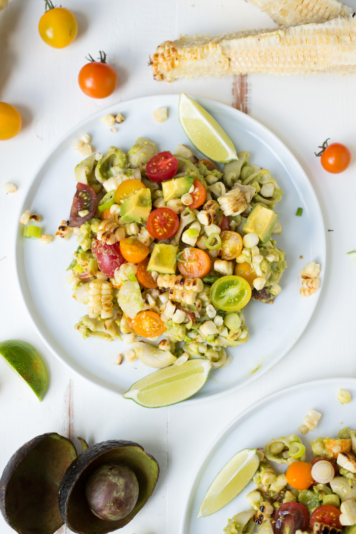 Grilled Corn Loaded Guacamole Pasta is lusciously creamy and packed with veggie goodness. A simple, delicious vegetarian main dish everyone will love!