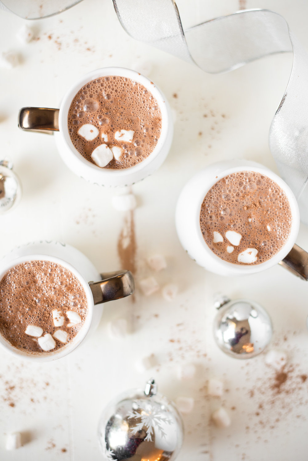 Skip the processed packets of hot cocoa and make your own at home with 3 simple ingredients. Warm, cozy, delicious, and completely dairy-free + naturally sweetened!