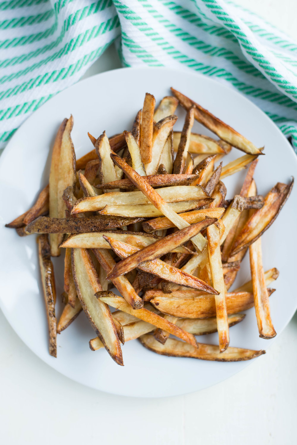 3 simple ingredients combine in these crunchy, crispy, golden-brown Friday Night Oven Fries.