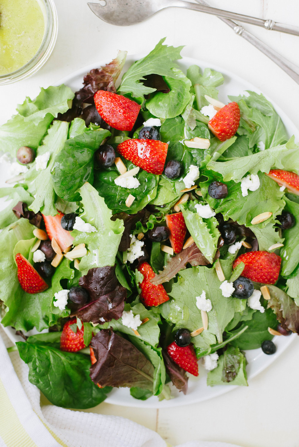 Beautifully simple and packed with flavor, Summer Berry Salad with Vanilla Bean Dressing is elegant, easy, and will take your salad game next level.