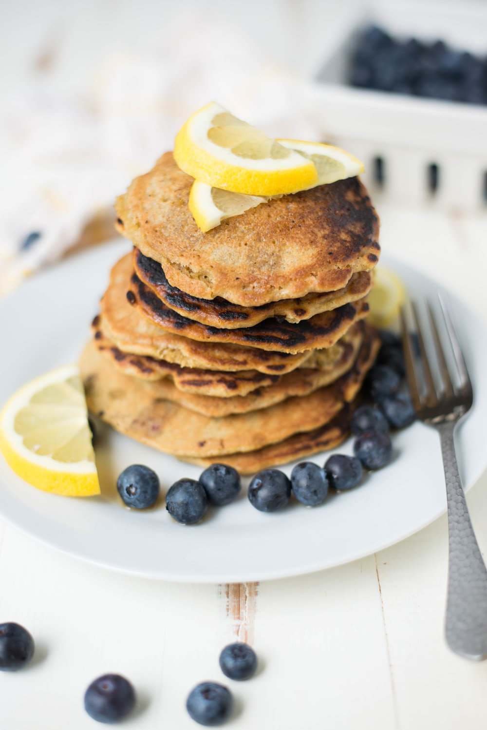 Tender, lightly sweet, and bursting with berries, One-Bowl Blueberry Lemon Pancakes are simple to whip up and make for the perfect, healthy weekend treat.