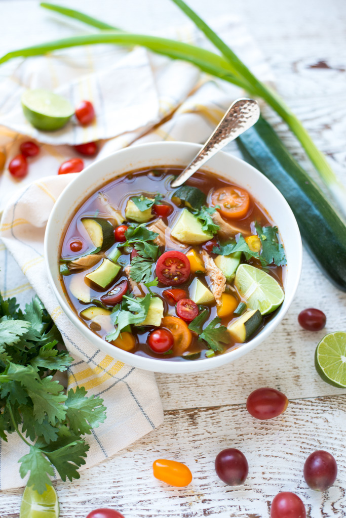 Simple to make and bursting with fresh summer flavors, Crockpot Loaded Mexican Chicken Soup is perfect any time of year. A great recipe for all your farmer's market finds, and dairy-free, gluten-free, paleo and Whole30 friendly!