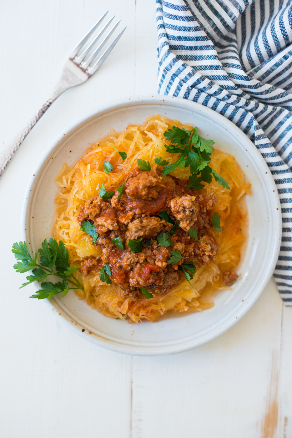 Instant Pot Spaghetti Squash & Short-Cut Bolognese is a one-pot wonder, since the meat sauce and spaghetti squash cook together for a simple, delicious meal with minimal clean up. A gluten-free, dairy-free, paleo, whole30 recipe the whole family will love. #realfoodwholelife #realfoodwholeliferecipe #instantpot #instantpotrecipe #paleo #paleorecipe #whole30 #whole30recipe #whole30instantpot #glutenfree #glutenfreerecipe #dairyfreerecipe #dairyfree #healthy #lowcarb #cleaneating