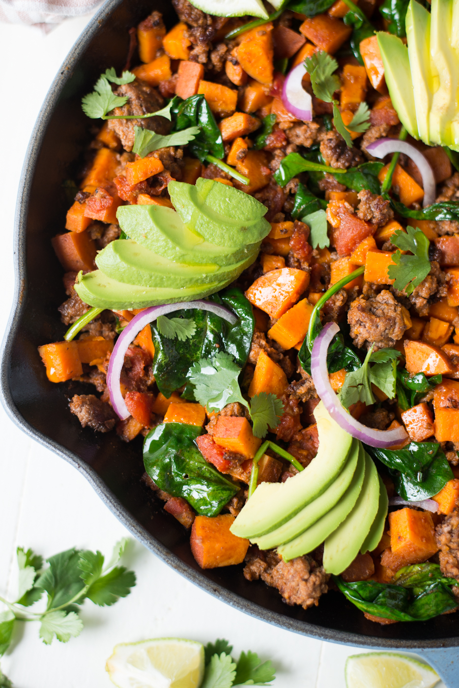 20-Minute Southwest Beef & Sweet Potato Skillet is a super simple and crazy flavorful weeknight meal that everyone will love. A gluten-free, dairy-free, whole30, one-pan recipe. #groundbeef #sweetpotato #weeknightrecipe #weeknightdinner #onepan #onepot #onepanrecipe #whole30recipe #januarywhole30 #winterrecipe #healthyrecipe #paleo #whole30 #dinner #glutenfree #dairyfree #realfoodrecipe #realfoodwholelife #recipe