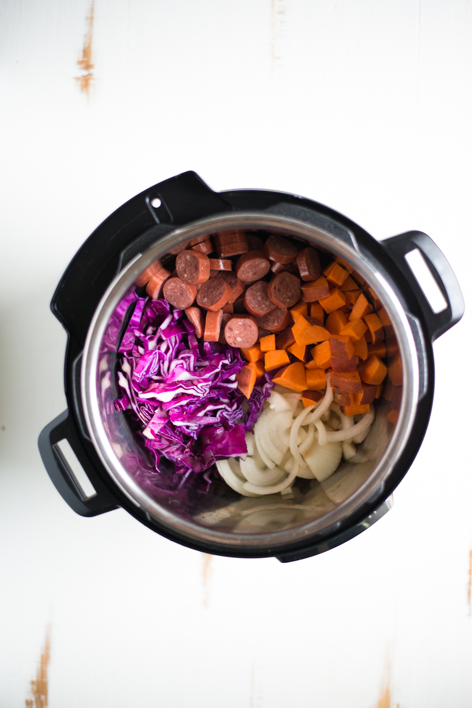 Sausage, Cabbage & Sweet Potato Stew is a super-simple, ultra comforting one-pot meal that comes together in a matter of minutes. A cozy, delicious gluten-free, dairy-free, whole30 recipe that can be made in the Instant Pot, Crockpot or stove top. #realfoodwholelife #realfoodwholeliferecipe #glutenfree #glutenfreerecipe #dairyfree #dairyfreerecipe #healthy #healthyrecipe #easyrecipe #quickrecipe #cleaneating #instantpot #crockpot #slowcooker #recipe #whole30 #whole30recipe