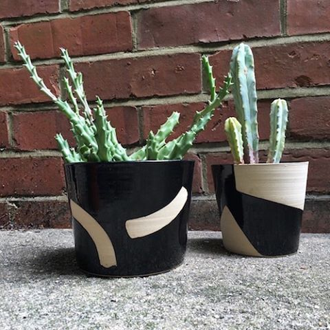 Did you know houseplants can help purify the air in your home? They are also great at softening corners or edges and can help create a sense of calm and tranquility. Why not show case them in beautiful planters such as these? The monochrome colour scheme will beautifully offset the colours of the plant. These beauts have been handmade by the talented Hannah in her garden studio in North London. Each planter is unique, helping to create a special personal touch to your home. #sustainableliving #giftshop #ethical #eco #sustainable #organic #organiccotton #organicliving #chemicalfree #fairtrade #homewares #interiorinspiration #interior_design #homesinterior #ecofriendly #naturalliving #handmadeaccessories #handmadeshop #shophandmade #handmadegifts #homeinterior #interiordecorating #bowl  #madeinlondon #ceramics #planters #planters #pots #plantpot #monochromemaves