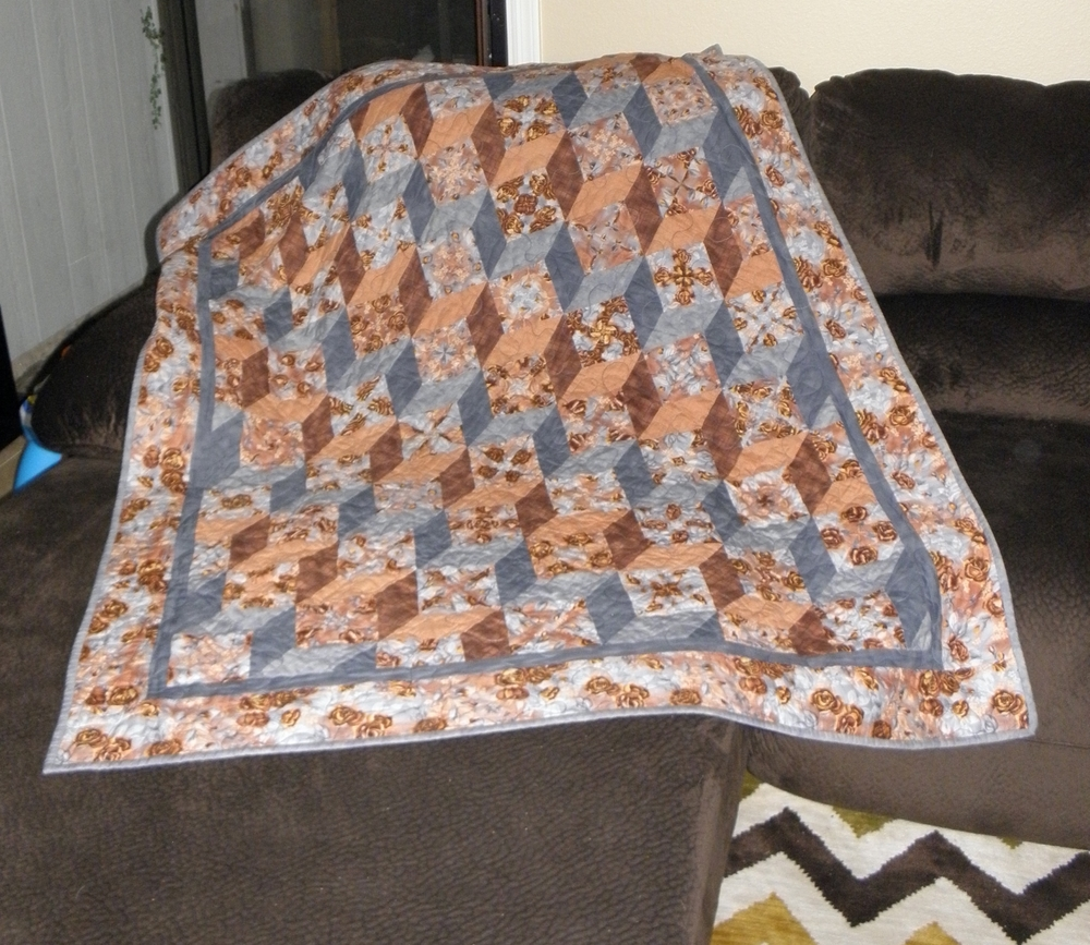 Stack 'n Whack tumbling block lap quilt made circa 1990's.