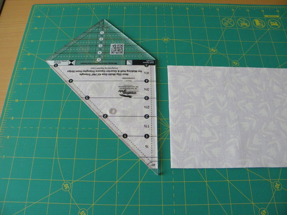 Line up the angled side of the ruler with the cut size of the strip set.