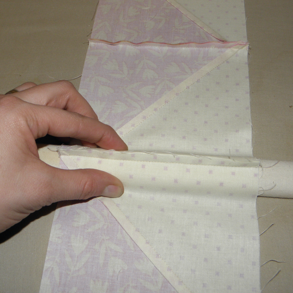 Pinch fabric on sides of stick to separate the seam.