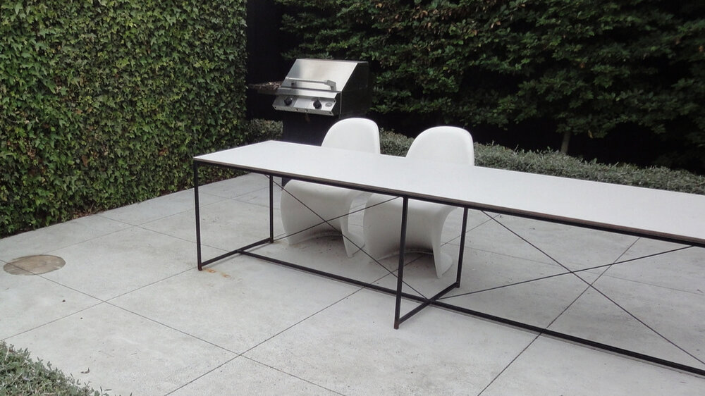 Poulson table by Workshed   The Poulson outdoor table is made from galvanized or stainless steel with a max board top. Available in any size or colour.