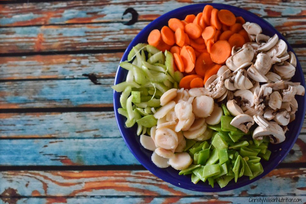A colorful variety of nutrient rich vegetables before getting tossed into the wok with marinated pork and additional seasonings.
