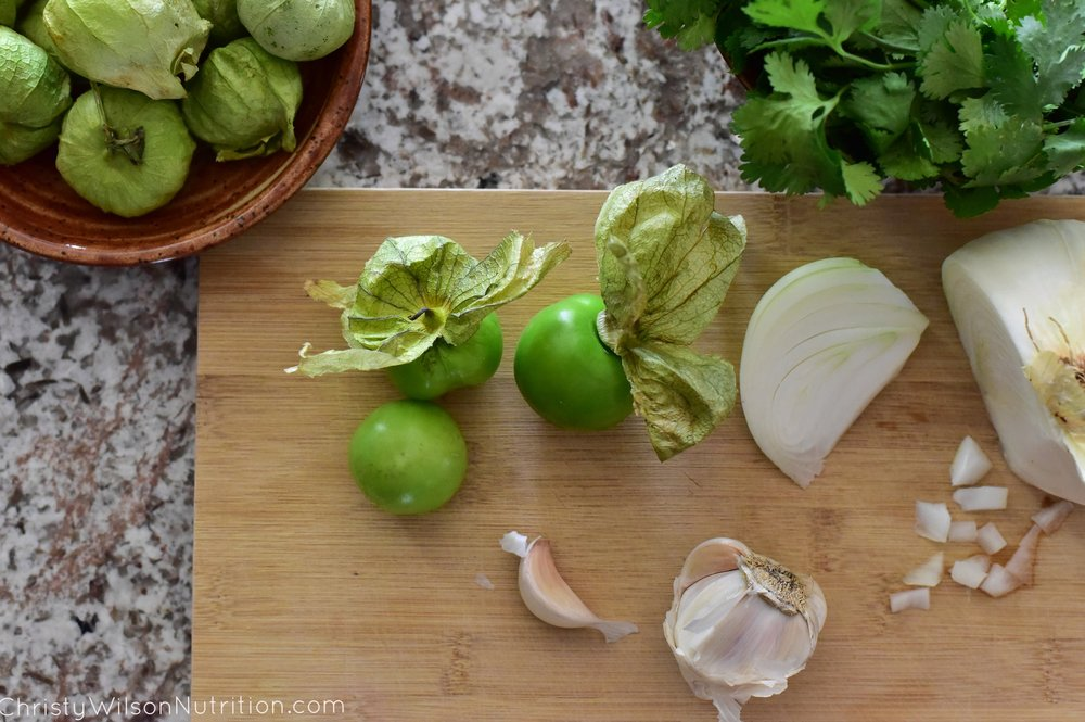 Prepping the tomatillos and other fresh ingredients for the dressing.