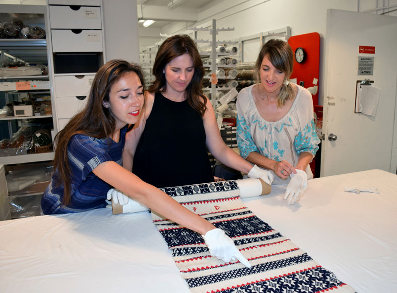 The Pollack design team in the textile collection at the Museum of International Folk Art. Left to Right: Molly Haynes, Chase Taylor, Rachel Doriss.