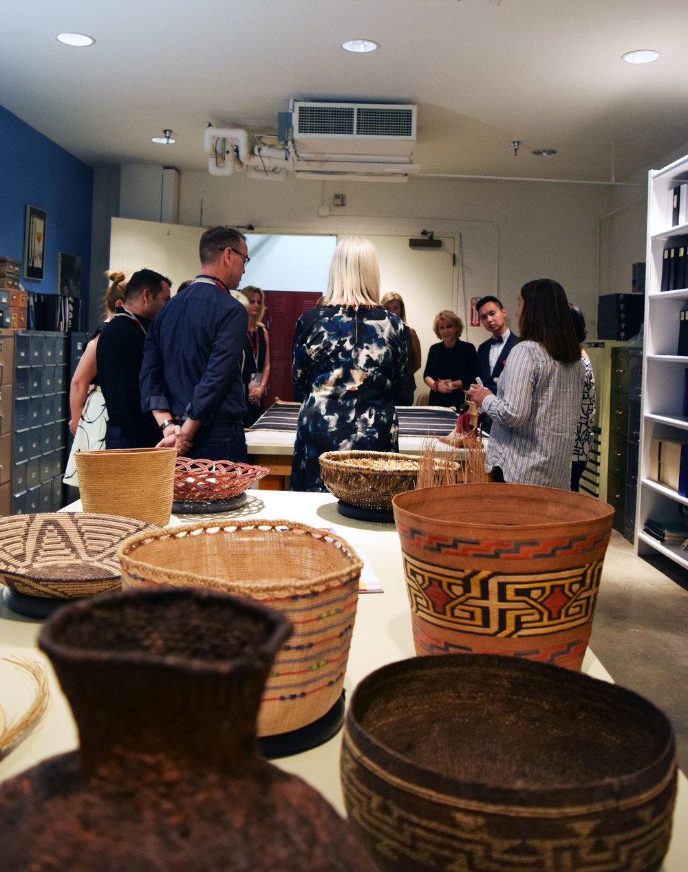 Touring the textile, pottery and basketry collection at the Museum of Indian Arts & Culture.