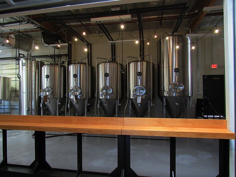 EVENING: TEMPORARY BAR SETUP LOOKING INTO BREWERY