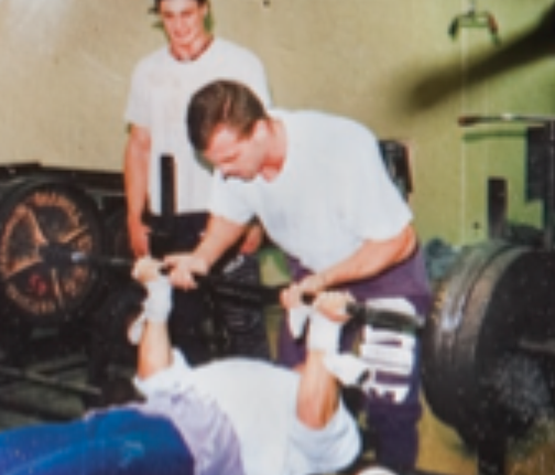 Jimmy, circa 1990, with 315 pounds on the reverse-grip bench press.