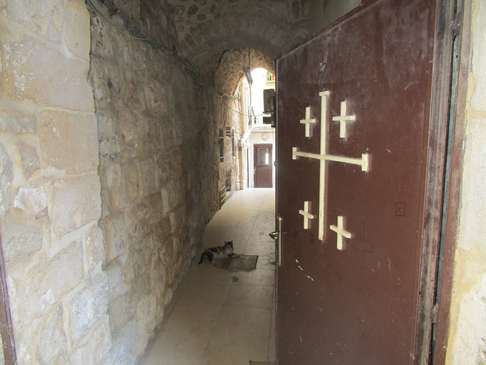 Jerusalem Cross and a cat. I loved taking shots of doorways and alleys. You should see my entire camera roll. (I should be a photographer.)
