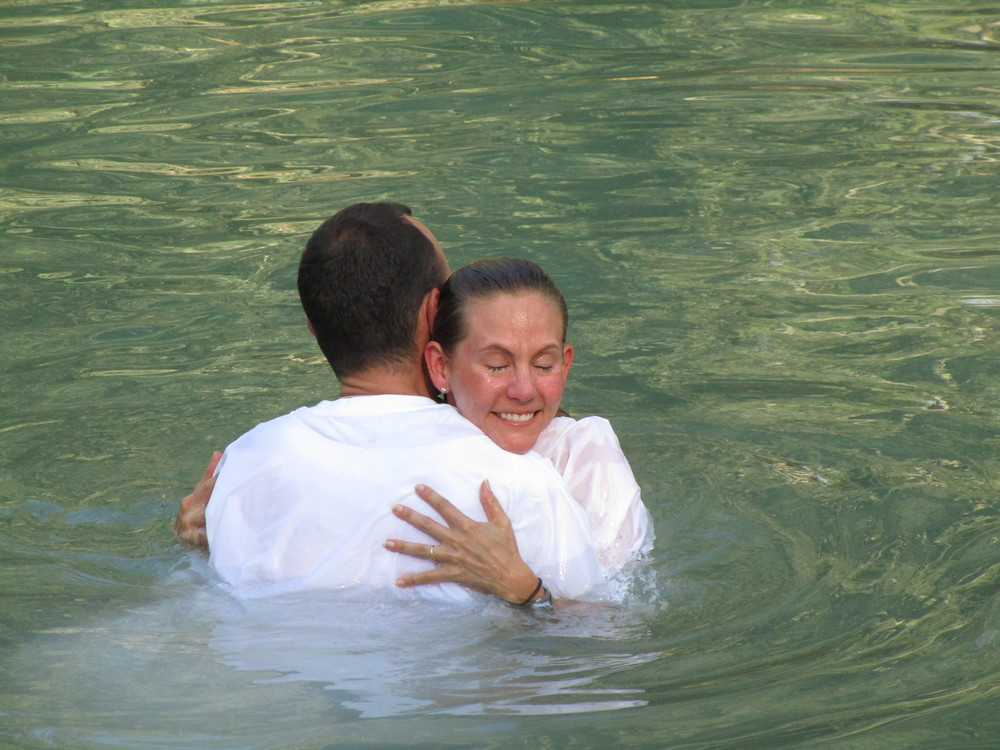 The love of my life and I baptizing each other in the Jordan River. Somewhere along this way Jesus met John the Baptist in the water.