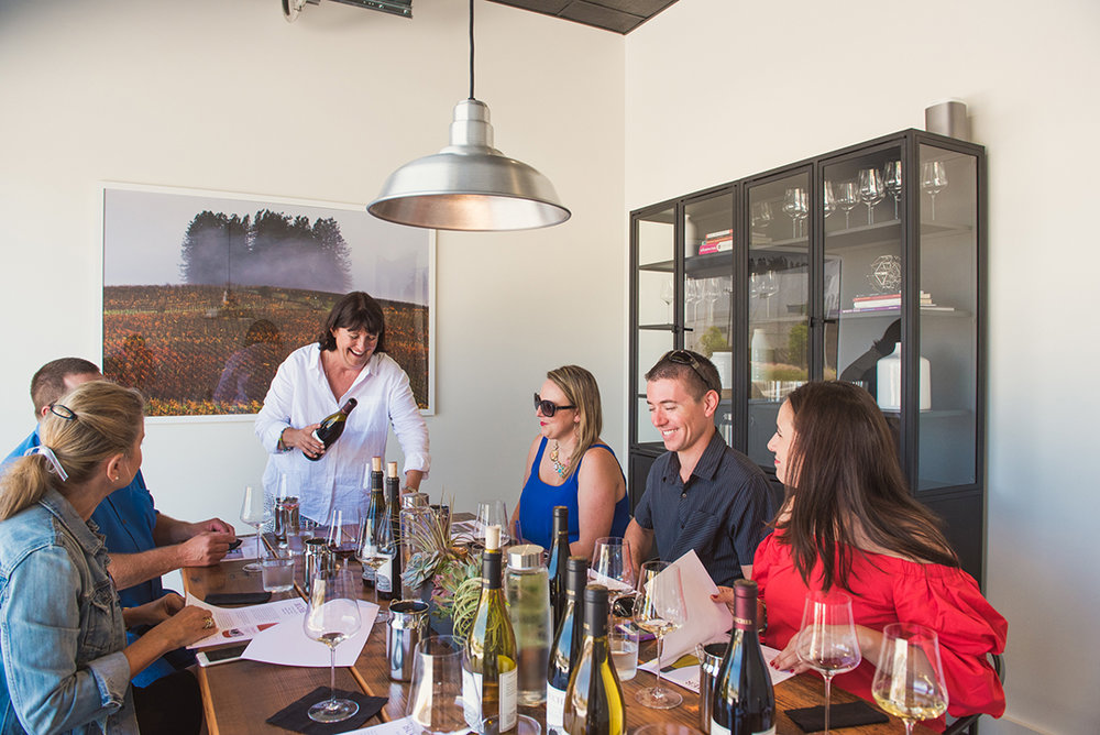 Diane Bucher of Bucher Wines hosting guests at their tasting room, Grand Cru Custom Crush.