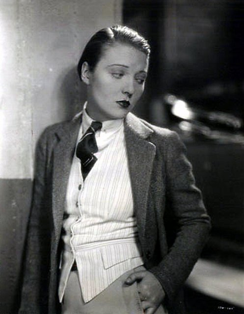 An art deco era woman in a suit