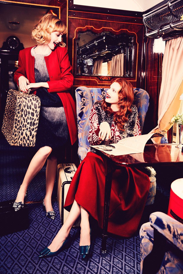 Two women in art deco era fashion with luggage