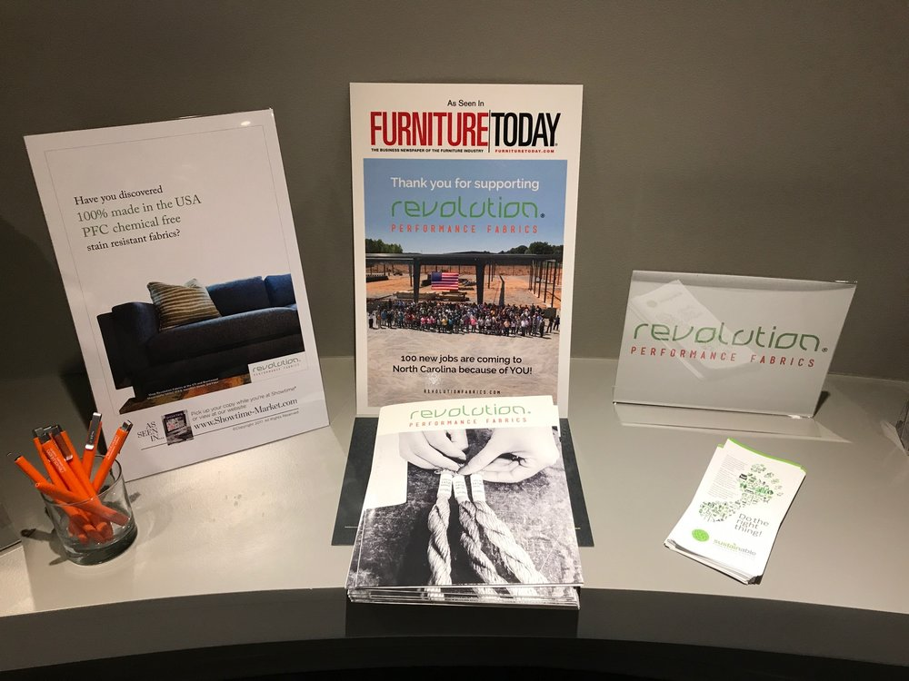 Above: Photos of our recent full page ads in Furniture Today magazine and Revolution PoP materials.