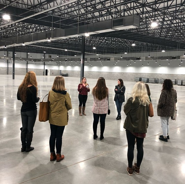 Jessica Dalton  leading her group through a tour of our new Plant 3!