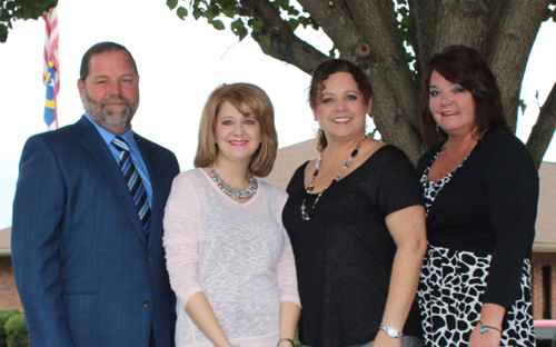 Above: The third generation Parker family (left to right) Adrian Parker, CEO; Rebecca Cox, Fabric Manager; Kim McRee, Marketing & Sales Director; Angie Wright, Interior Designer