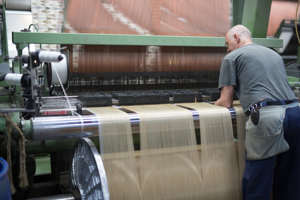 A loom creating woven fabrics