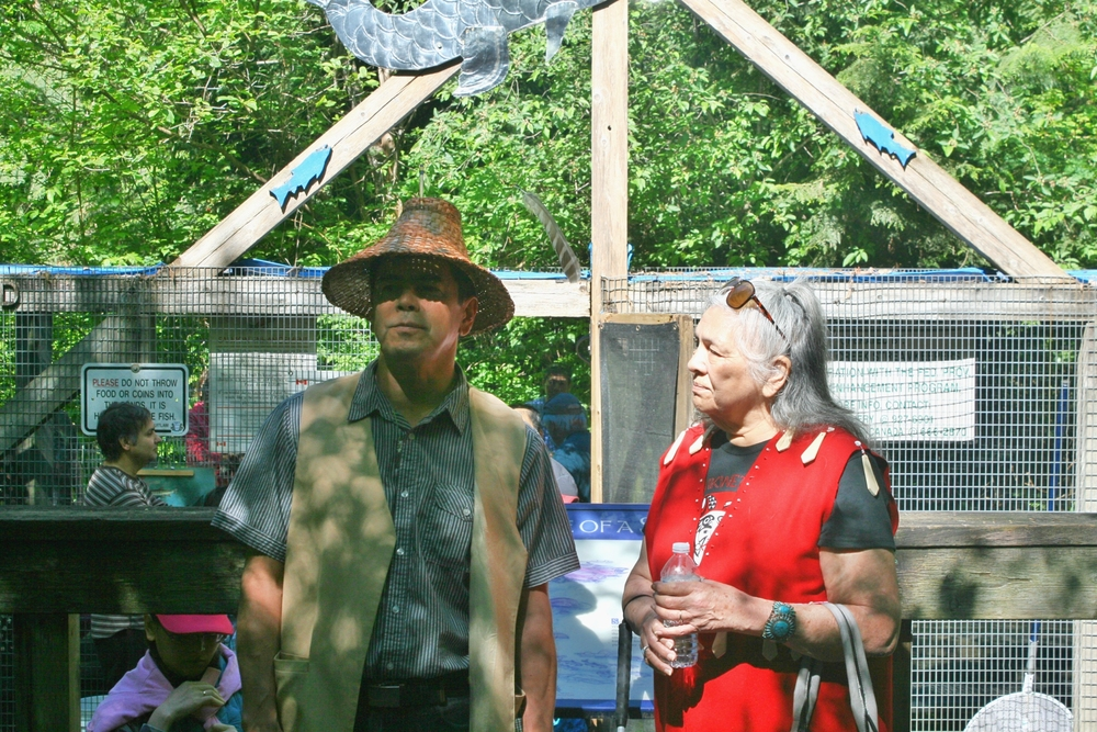 Honourary guests from Kwikwetlem First Nation, Ed Hall, Councillor and elder Beverley Mrockowski speak at the opening of Salmon Leave Home on May 1st (Photo: Robbin Whachell / HSWS)