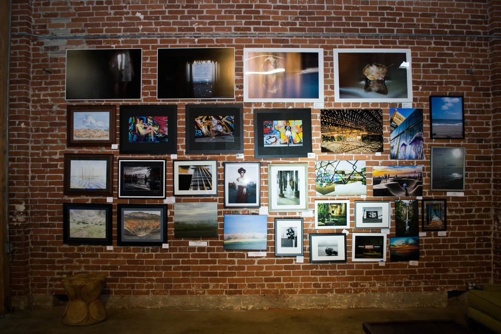 Wall of artists and photographers from the Beyond The Lines Art show in May 2016.