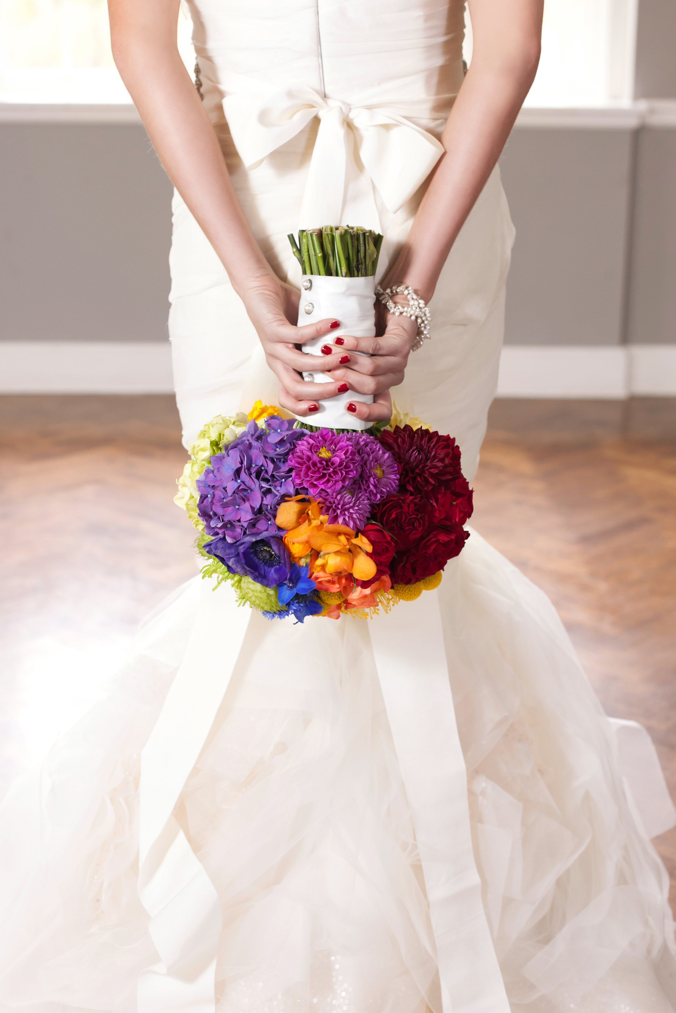 A tasteful rainbow bride bouquet designed by Just Bloomed