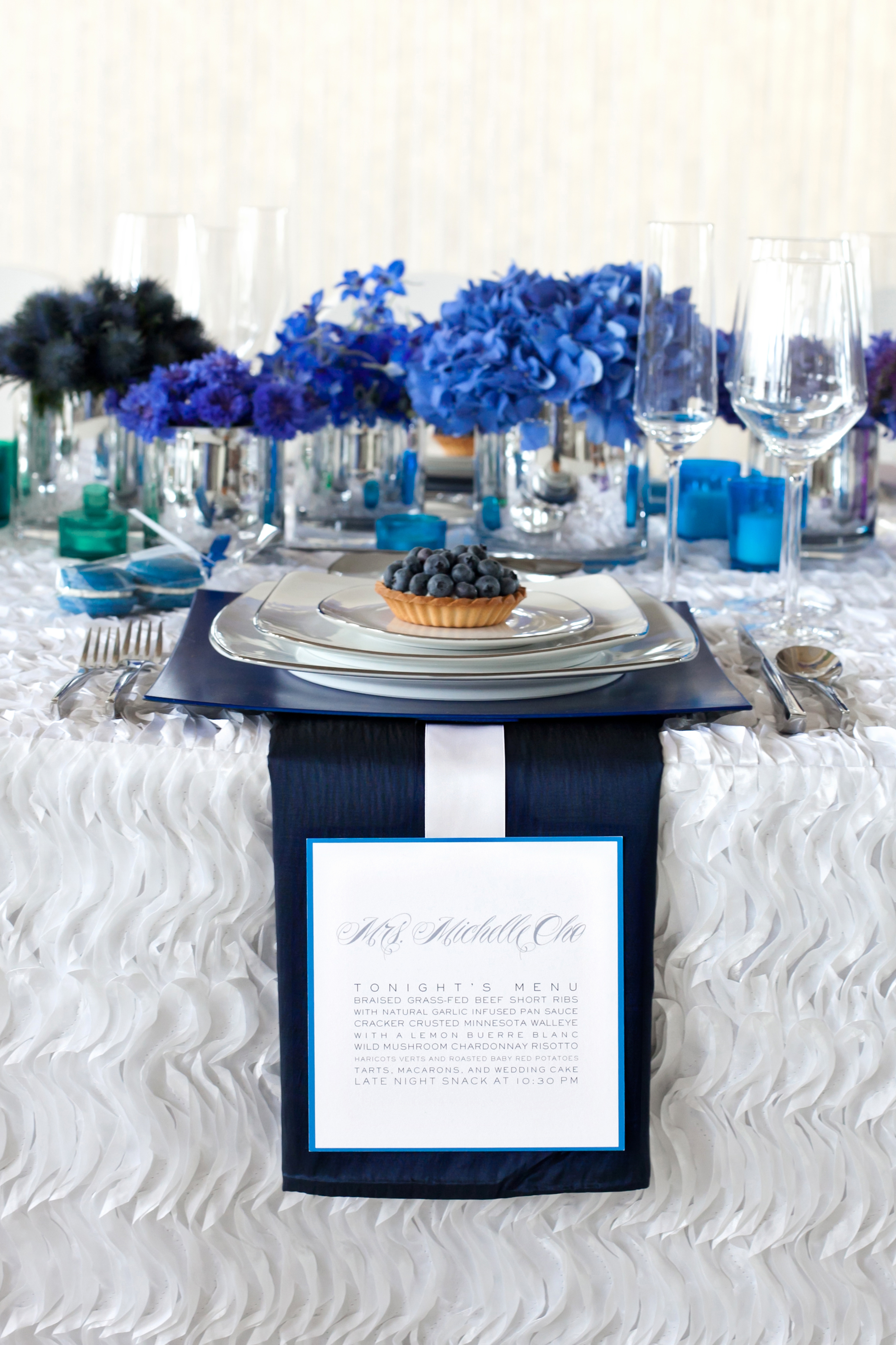 A monochromatic blue table setting