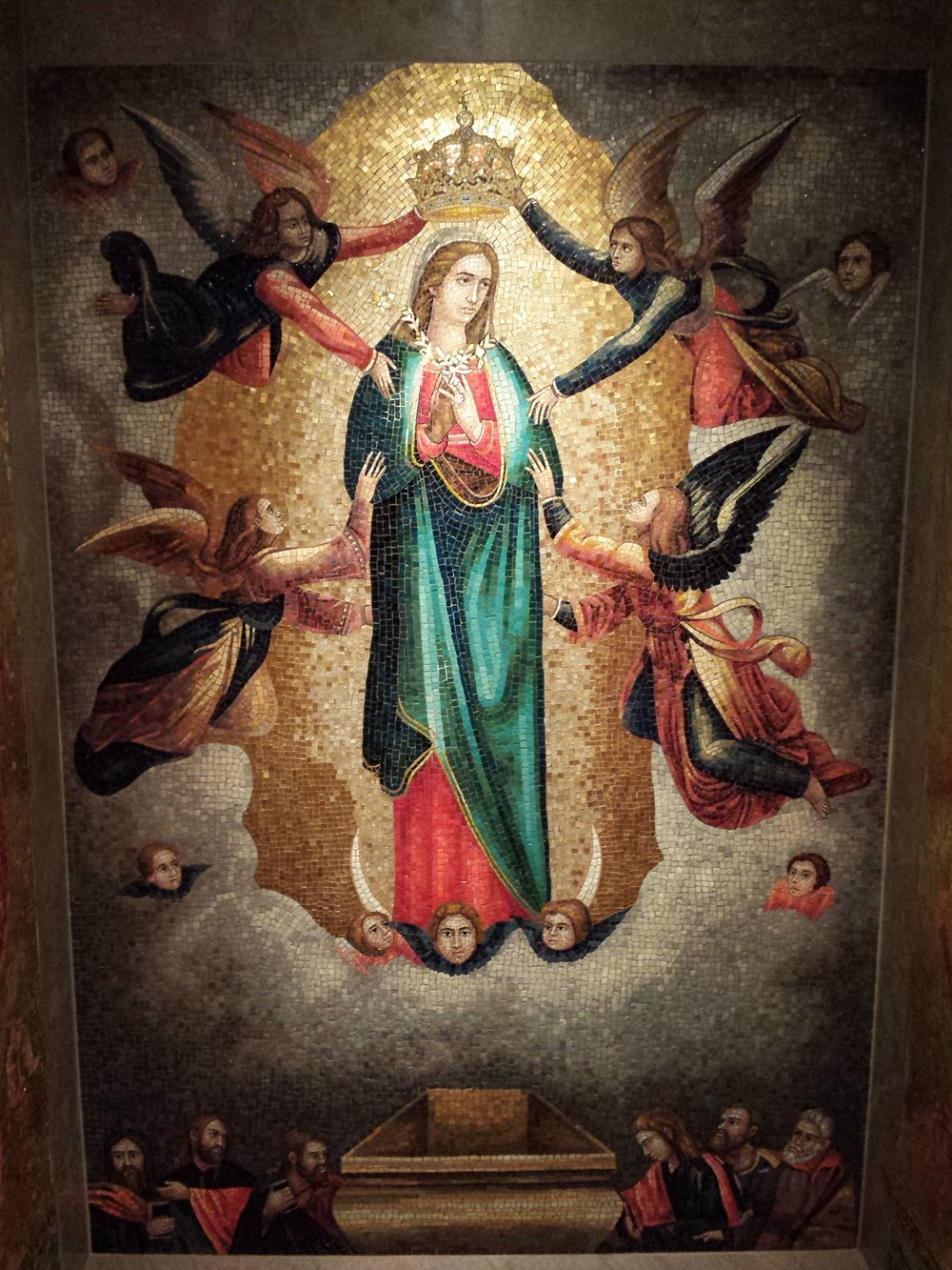 The Blessed Mother crowned as Queen of Heaven and earth, as seen in a mosaic at the National Basilica of the Shrine of the Immaculate Conception.