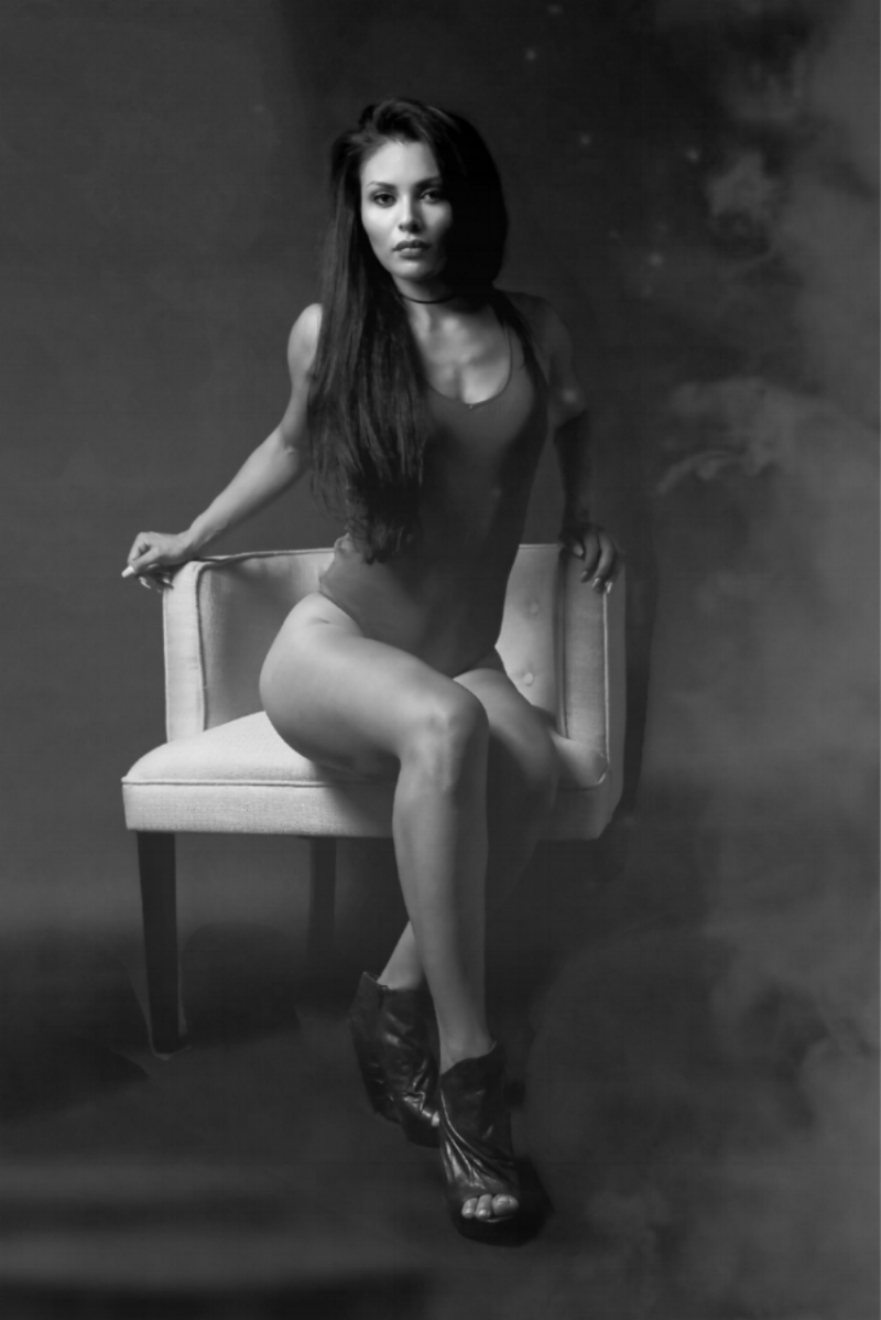 Black & White Photography takes on a whole different meaning.  Here Gabriela had on a pink outfit.  With the smoke add in the picture and it being devoid of color, this photo is a bit more mysterious than the colored picture.