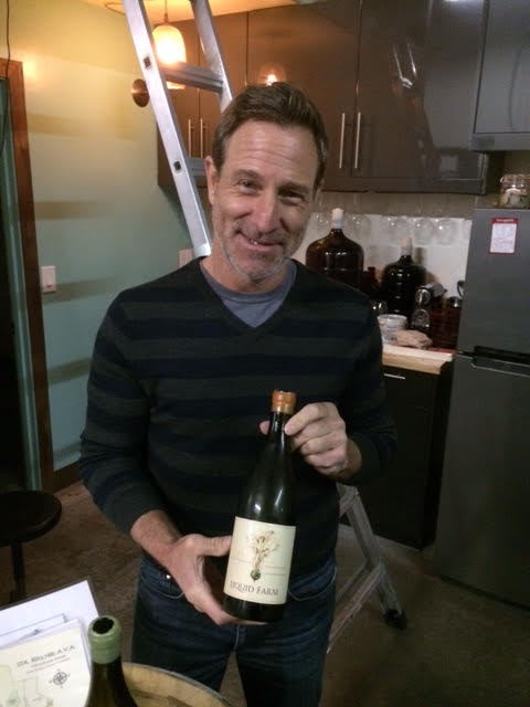 Owner Jeff Nelson with one of his wonderful bottles of Chardonnay