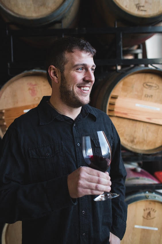 Superstar winemaker, Brandon Moss, enjoying a glass of Gramercy Cellars red, in his barrel room
