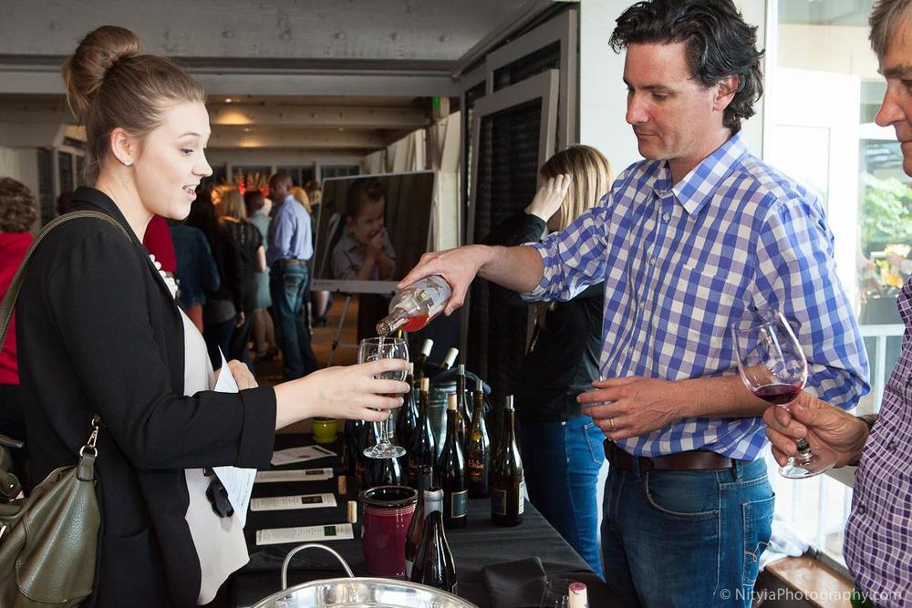 Head winemaker at Purple Star, Ryan Johnson, pours some of his excellent wine for a guest (photo by Nityia Photography)