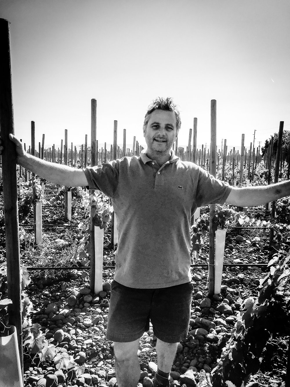 The iconic vigneron, Christophe Baron, in his cobblestone filled vineyard.
