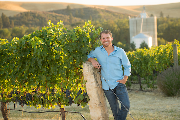 Great photo of superstar winemaker, Chris Figgins, in his vineyard.