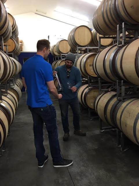 Here I am sampling some wines out of barrel with superstar winemaker, Matt Reynvaan.