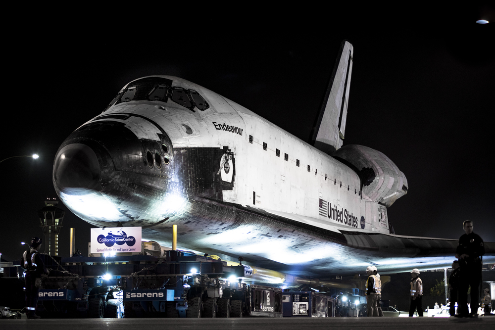 LOS ANGELES -- Space Shuttle Endeavour departs Los Angeles International Airport (LAX) in the early morning of Friday, October 12, 2012.  Endeavour will make its way through the streets of Los Angeles to reach its final destination at the California Science Center. (Photograph by Jonathen E. Davis)