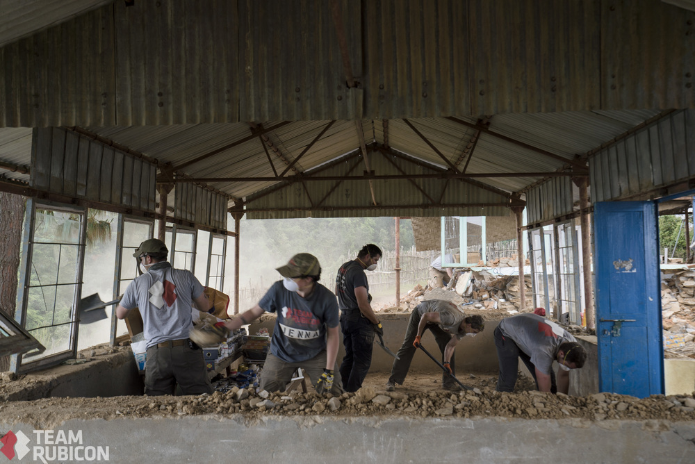 Debris removal from a local school in Sermantang, Nepal.