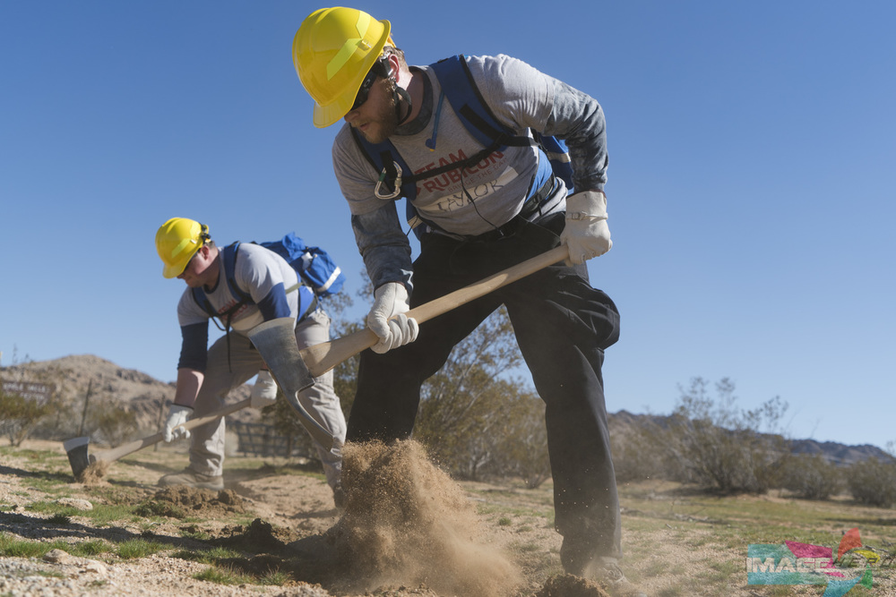 Team Rubicon members Christopher Taylor (right) and Marc Hurwitz lead the pack by setting up the barrier on a fireline during a field training exercise for Fire Fighter Type 2.