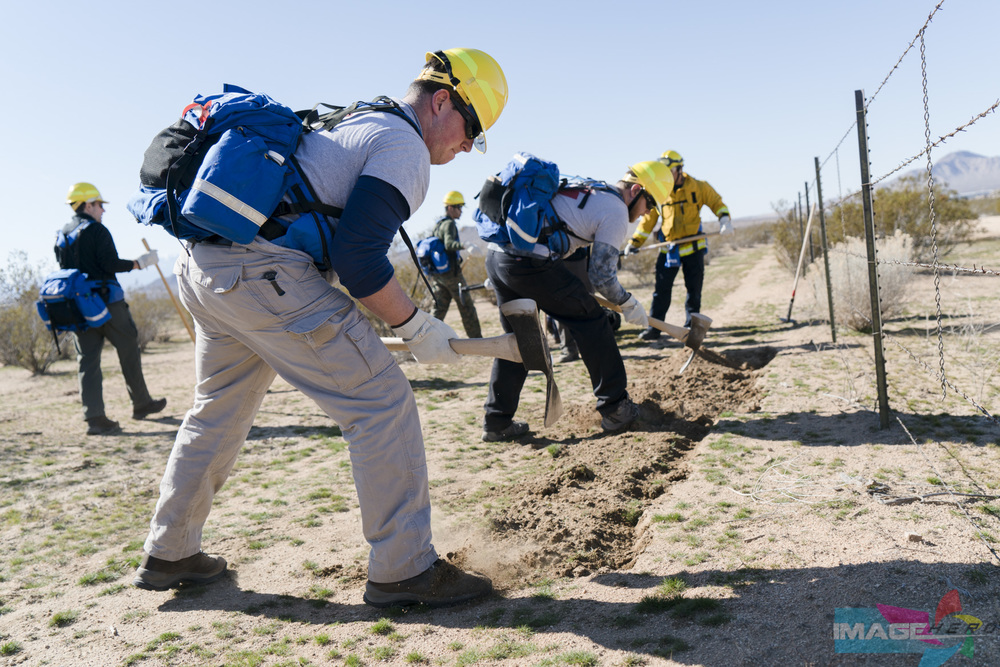 Team Rubicon member Marc Hurwitz is the frontman setting up the barrier on a fireline during a field training exercise for Fire Fighter Type 2.