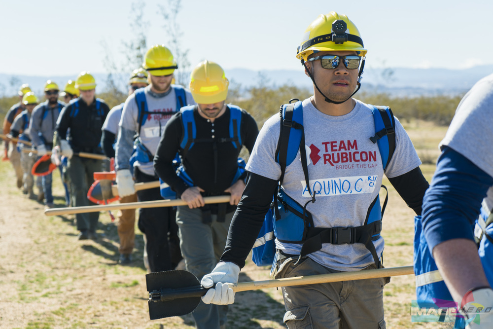 Team Rubicon member Charles Aquino and other TR members march in a single file line toward their first exercise.