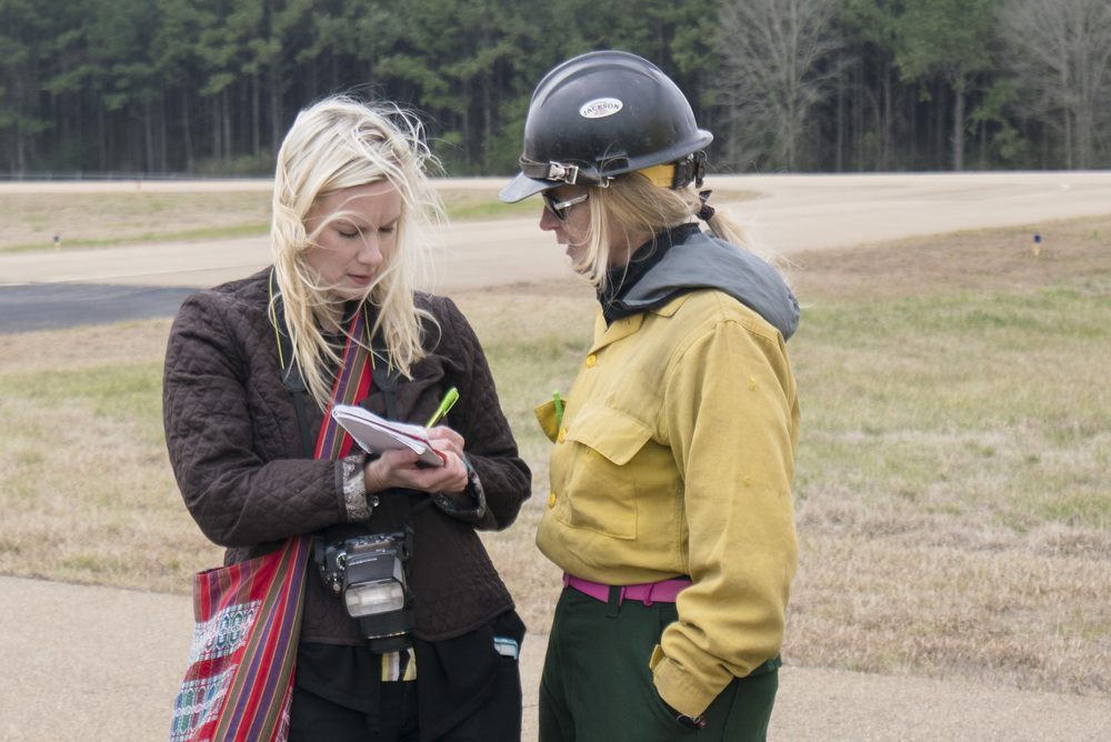 Team Rubicon member Pat Gustafson, right, is interviewed by Emily Hemans for the Clarion-Ledger newspaper. Team Rubicon, with a partnership with the Bureau of Land Management, are being trained to become helicopter crewmembers for helitack teams to combat forest fires.  This is the first cohort to go to through this specialize training tailored for Team Rubicon volunteers.