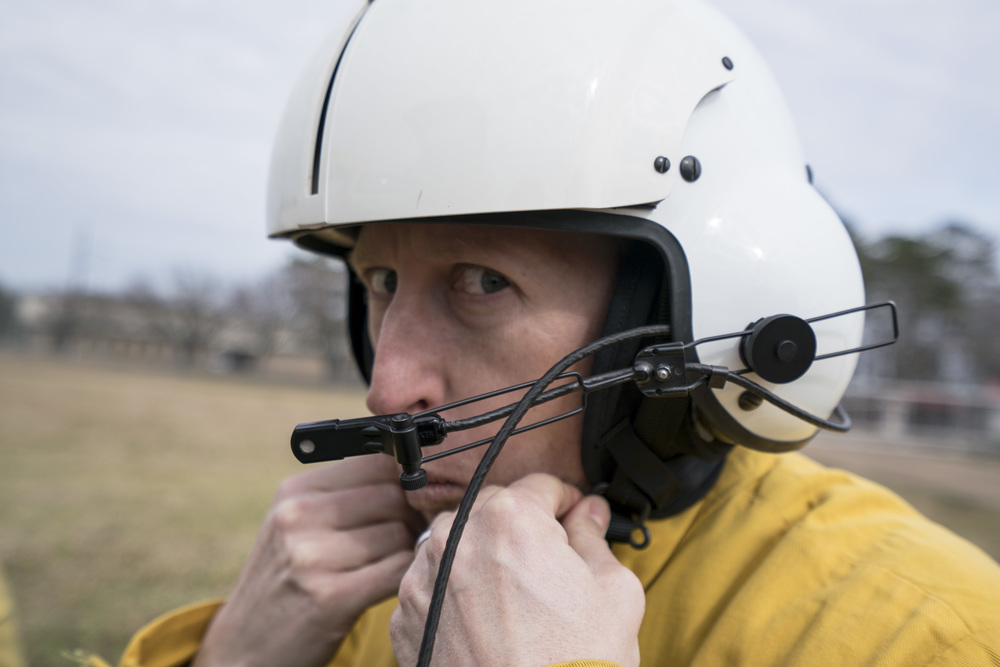 Team Rubicon member Travis Widder puts on a helitack flight helmet. Team Rubicon, with a partnership with the Bureau of Land Management, are being trained to become helicopter crewmembers for helitack teams to combat forest fires.  This is the first cohort to go to through this specialize training tailored for Team Rubicon volunteers.